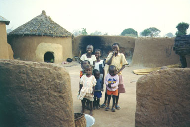 Bawku, Ghana, 1993. Typical style of housing in the North of Ghana. The children in the     picture are members of the Kussie tribe. Photo by Peace Corps Volunteer Wayne Breslyn.