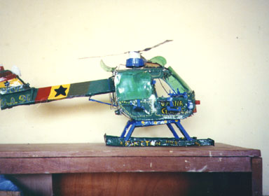 Bawku, Ghana, 1994. Children showed the most amazing creativity. This helicopter  was made from Sprite bottles, toothpaste caps and discarded metal.  Photo by Peace Corps Volunteer Wayne Breslyn.