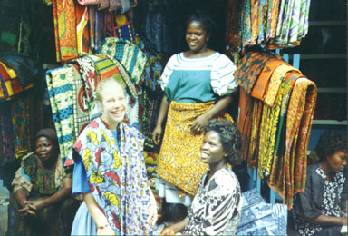Kumasi, Ghana, 1993. Ghanaians love bright colors. A large section of the market in Kumasi is dedicated to selling cloth for dresses and other clothing. Photo by Peace Corps Volunteer Wayne Breslyn.