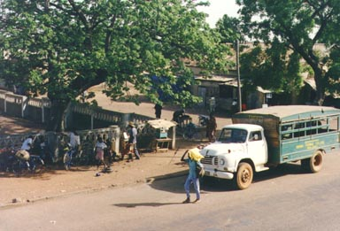 Bawku, Ghana, 1993. The main road in Bawku is used heavily by trucks like the one in this  picture. This particular truck belongs to Bawku Secondary School where the photographer  taught Science. Photo by Peace Corps Volunteer Wayne Breslyn